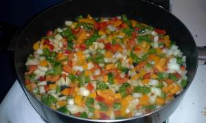 Last weekend I cooked a dish that used red, green and orange peppers, plus onions.